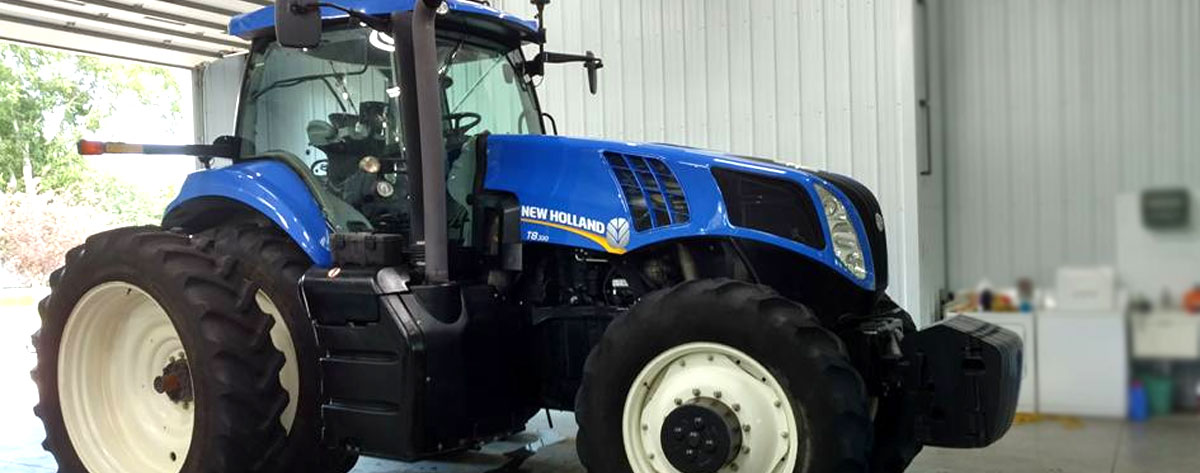 Large New Holland tractor freshly detailed at NCS Auto & Detail in Sauk Centre, MN